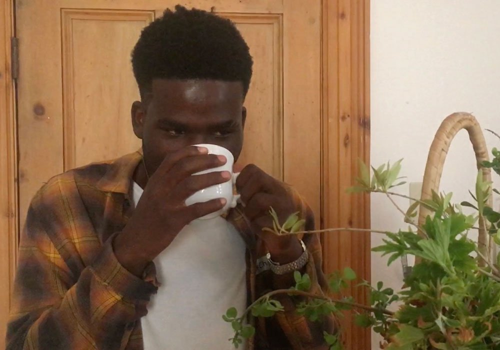 Christian enjoys a cup of Fynbos tea in our environmental project.
