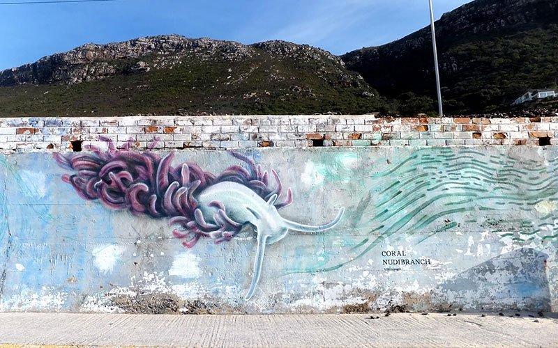 Graffiti mural of a coral nudibranch.