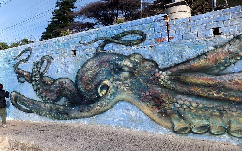 Large graffiti mural of an octopus.