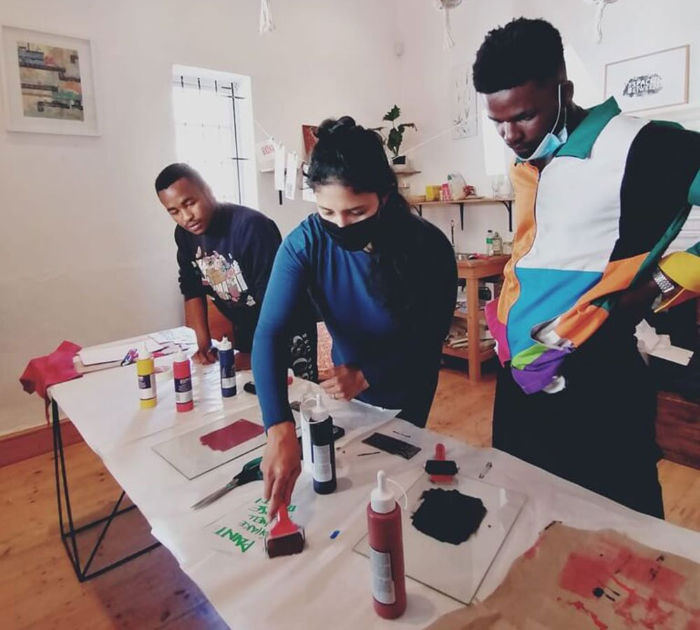 Our print-makers learning how to create and use printmaking tools with Zayaan Khan.